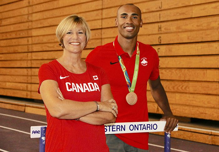 Vickie Croley, the Mustangs' head coach for Track and Field works with Olympic decathlete and 2016 bronze medalist Damian Warner, left. Croley has coached Warner since 2010 and accompanied the 26-year-old athlete to the Olympic Games in Rio De Janeiro last month, where he finished the competition with 8,666 points, behind only Ashton Eaton of the United States (8,893 points) and Kevin Mayer of France (8,834).